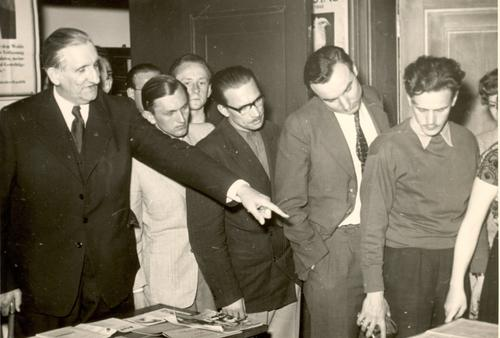 Emil Dovifat is shown giving visitors a tour of the Institute (1952)