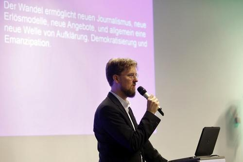 "This year's speaker, Dr. Christian Humborg, member of the commitee of trustees of CORRECTIV holds talks about the topic ""between rse and fall- media in between platform capitalism"""